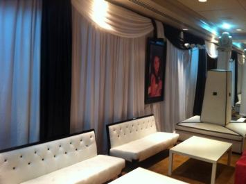 Pleated-black-white-event-drapes-with-white-couches