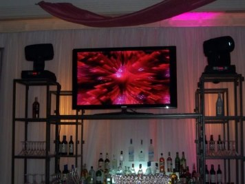 Video-screen-on-bar-shelves-for-mitzvah