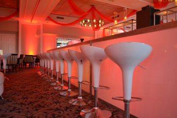 scoop stools at LED bar