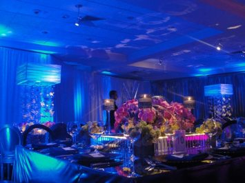 floral centerpieces on event tables with lighting
