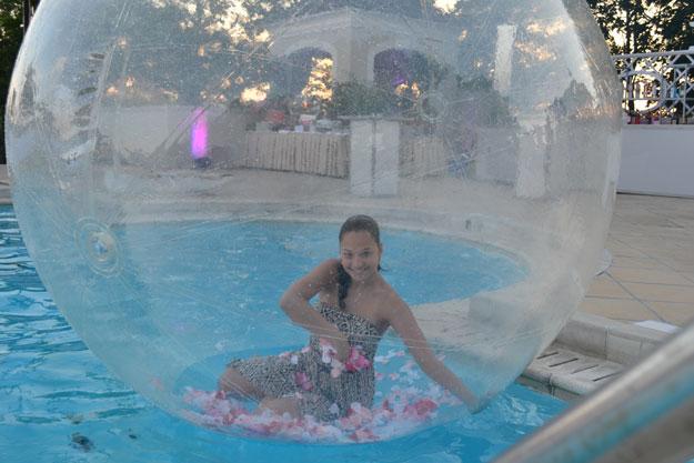 girl in bubble in pool