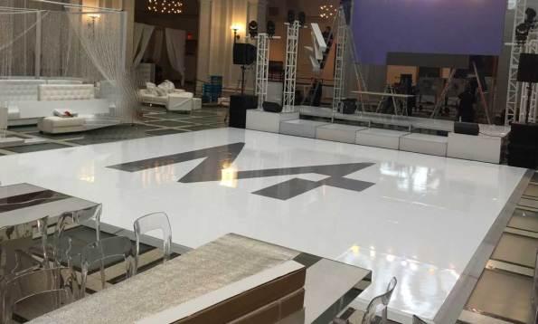 High-gloss-white-dance-floor-with-logo-sticker