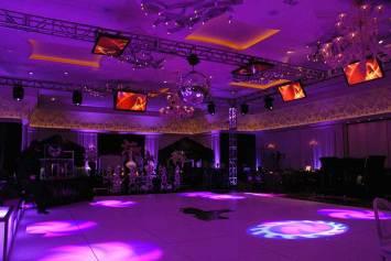 custom lighting, video screens, disco ball, and white dance floor