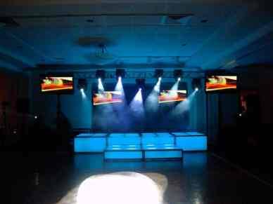 light blue LED stage decks, video screens, theatrical lighting