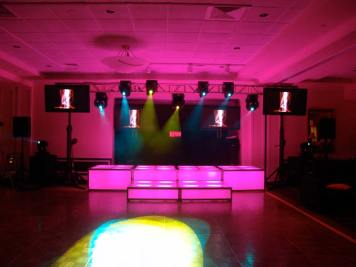 fuscia LED stage decks, video screens, theatrical lighting