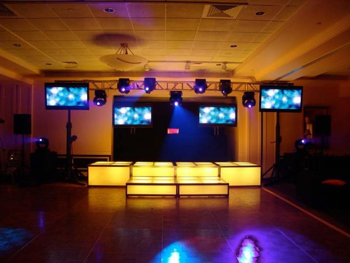 yellow LED stage decks, video screens, theatrical lighting