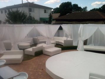 privacy booths with pipe and drape and white lounge decor