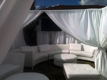 lounge decor, curved couch, white pipe and drape