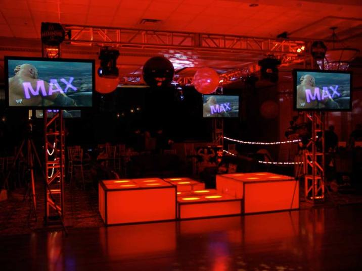 LED stage decks with video screens mounted on truss
