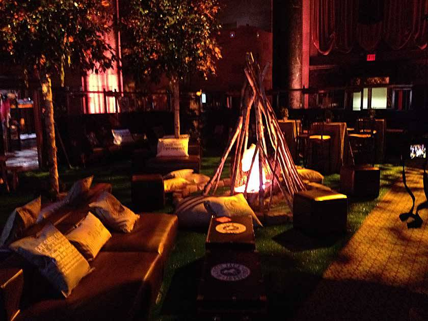 brown lounge furniture and giant fire pit