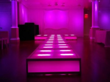 LED-stage-deck-runway-with-stage-backdrop
