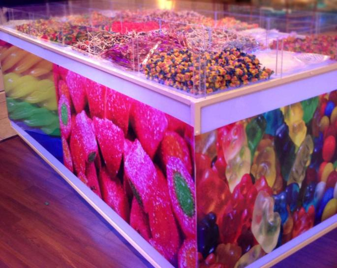 giant-candy-bar-decorated-with-posters-of-candy-and-filled-with-various-candies