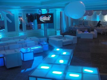 White-orbs-and-white-lounge-furniture-and-LED-stage-decks