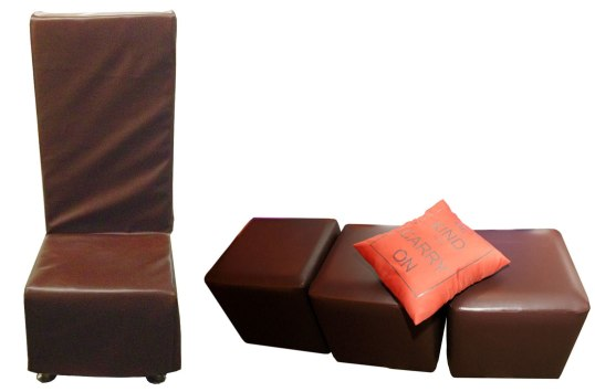 Amber-brown-hi-back-seating-with-ottomans-and-personalized-pillows-for-bat-mitzvah