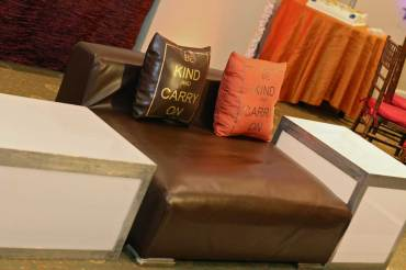 Amber-brown-low-back-sofa-and-custom-pillows