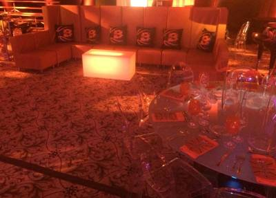 Basketball-mitzvah-with-hi-back-couch-illuminated-table-round-tables-with-acrylic-chairs