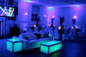 Blue-mitzvah-white-lounge-decor-glow-cubes-video-screens-and-community-tables