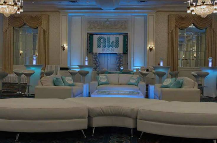 White-Lounge-decor-with-half-moon-seating-illuminated-hi-boys