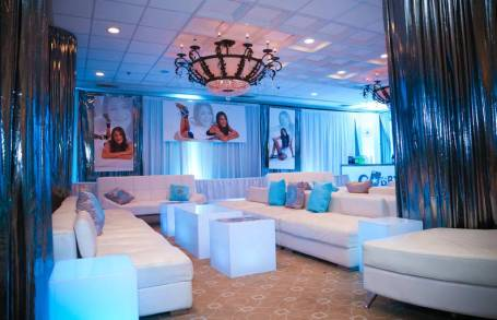 mitzvah-for-gabby-with-metallic-drapes-white-furniture-personalized-pillows-and-posters