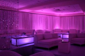 pink-mitzvah-lounge-decor-illuminated-tables-sparkle-bead-curtain-and-illuminated-tables