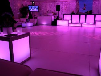 pink-mitzvah-pink-dance-floor-rental-with-LED-stage-decks-beaded-pipe-and-drape