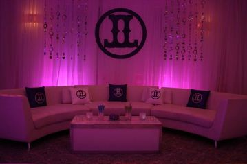 pink-mitzvah-round-couch-with-sheer-drapes-cut-out-logo-custom-pillows-and-illuminated-table