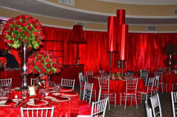 remi-bat-mitzvah-with-red-bar-red-tablecloths-red-metallic-centerpieces-and-photo-posters