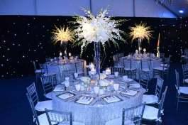 space theme bar mitzvah decor with silver linens, solar centerpieces