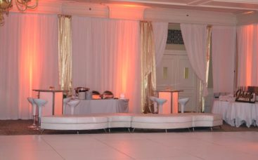 white-and-gold-mitzvah-with-gold-pipe-and-drape-curved-couch-illuminated-hi-boys