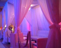 white-and-gold-privacy-booths-with-ambiance-lighting