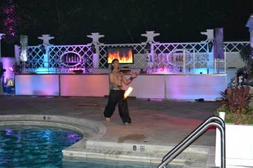Country-Club-Event-Production-Fire-Video-with-Fire-Performer-and-Illuminated-Bar