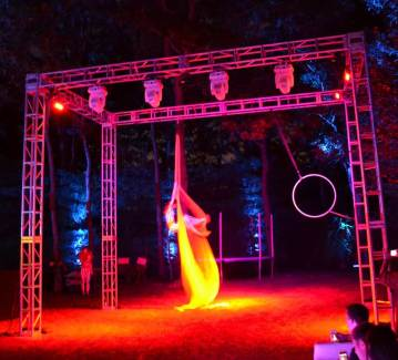 Graduation-Event-Production-Truss-with-Acrobat-and-fire-lighting