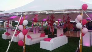 Sweet-16-Outdoor-Tent-with-White-Lounge-Decor-and-Pink-Pillows