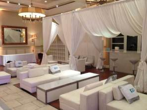 IGO-Corporate-Event-with-White-Louge-Decor-Custom-Pillows-Illuminated-Tables-Draping-and-Bar-Stools