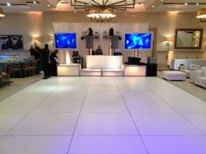 IGO-Corporate-Event-with-White-Portable-Dance-Floor-LED-Stage-Decks-and-DJ-Booth-and-Video-Screens