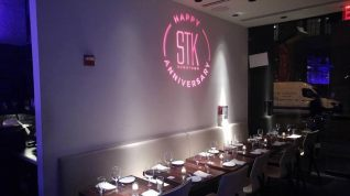 STK-Corporate-Event-Logo-Projected-on-Wall