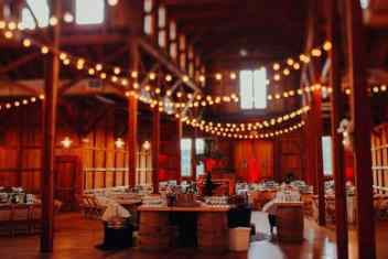 Barn-wedding-decor-with-rustic-tables-and-country-decor
