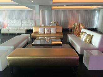 Gold-and-white-lounge-decor-with-sparkle-pillows
