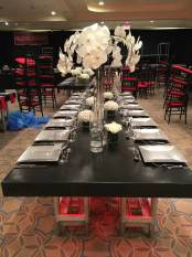 leather-covered-tables-with-acrylic-chairs-setting-up