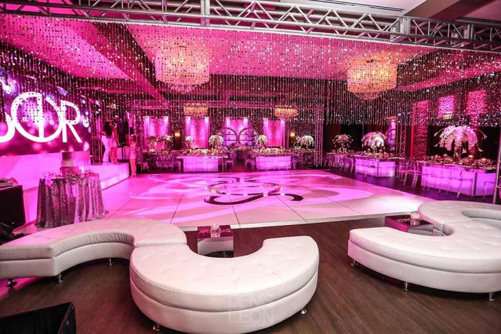Bat-mitvah--event-decor-white-dance-floor-curved-couches-beaded-semi-curtain-community-tables-with-centerpieces