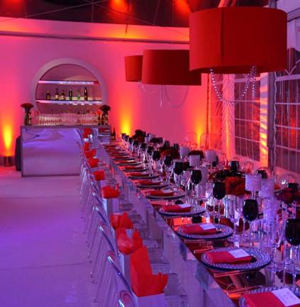 mirrored-community-table-red-shades-mirrored-beverage-bar