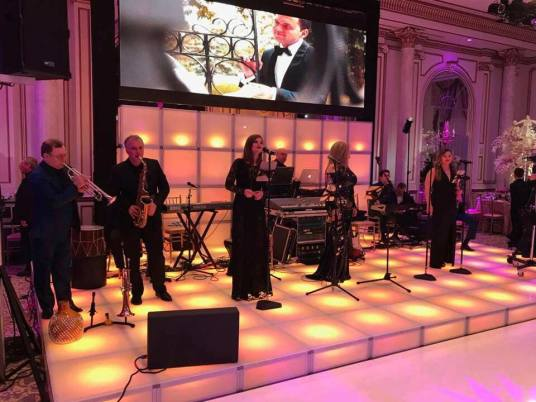 white-LED-stage-decks-with-video-wall-and-wedding-entertainers-on-stage