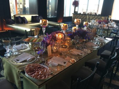 Event-production-gold-lounge-decor-with-gold-tufted-bar-andfancy-dinner-table-settings