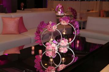 White-lounge-couches-with-custom-pillows-and-mirror-table-with-rose-and-silver-centerpies-and-candles