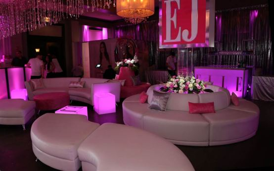 White-lounge-furniture-with-custom-sign-glow-cubes-and-custom-pillows