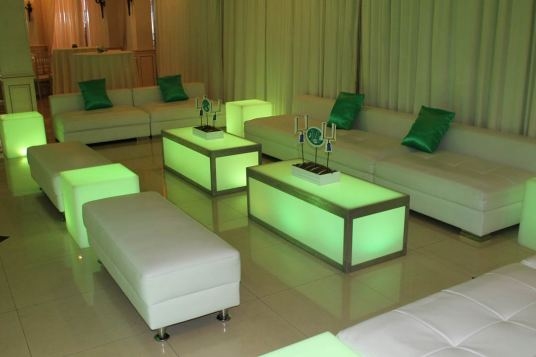 White-low-back-couches-and-benches-with-illuminated-party-tables-and-custom-centerpieces