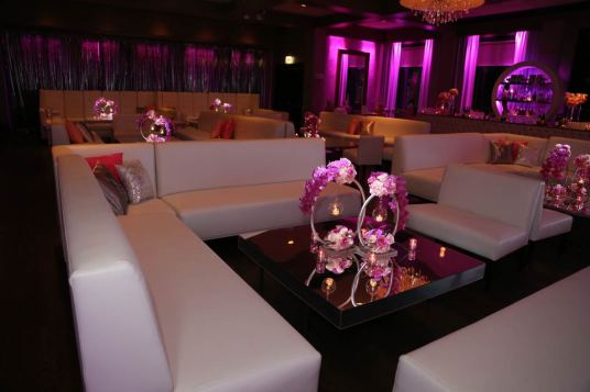 white-lounge-decor-pink-custom-pillows-mirrored-table-pink-rose-and-silver-candle-holders-end-table-glow-cubes