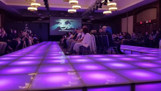 LED-stage-decks-with-chairs-for-fashion-runway-and-video-wall