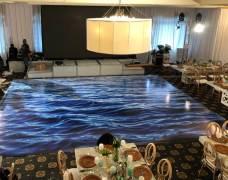 Portable dance floor that looks like ocean water