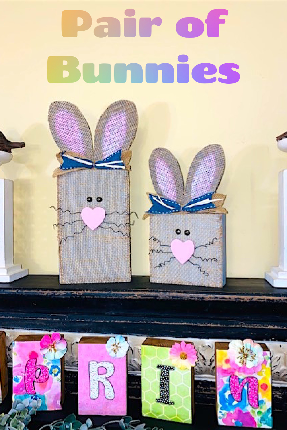 Wooden 2x6's with Burlap on top. They have ears made from thin wood.  Eyes are upholstery tacks and whiskers are made from curled wire.  The nose is a heart shaped piece of wood.